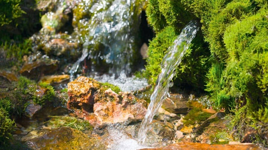 Why Does Water Flow out of a Spring?